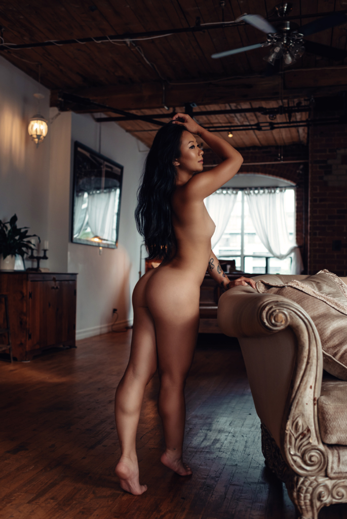 Naked girl near the sofa