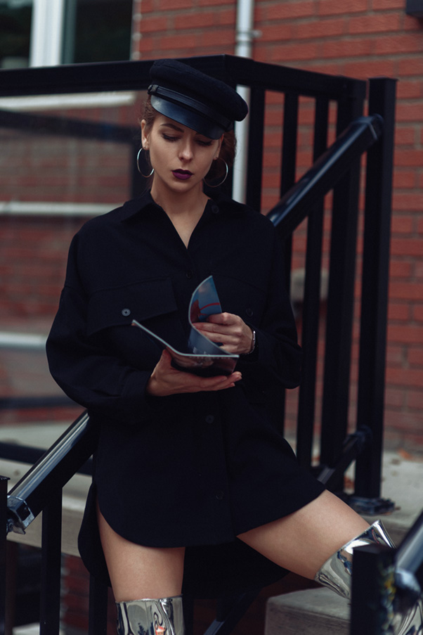 A woman is reading the magazine